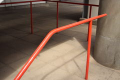 Red railing going down Stock Photo