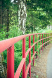 Red railings in the park Stock Photo
