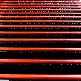 Red railings with rain drops Stock Image