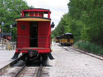 Red railroad carriage on train track. Red railroad carriage on railroad in summertime Royalty Free Stock Image