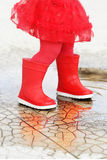 Red rain boots Stock Photography