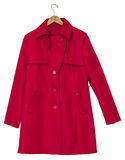 Red Raincoat on a Hanger. Red women's raincoat on a hanger, isolated on white. Clipping path included stock photo
