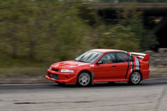 Red rally car. Red Sports car with motion blur Royalty Free Stock Images