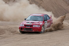 Red rally car Mitsubishi Lancer. ROSTOV, RUSSIA - JULY 27: Alex Popov drives a Mitsubishi Lancer  car during Rostov Velikiy Russian rally championship on July 27 Royalty Free Stock Images