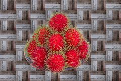 Red rambutan are edible in the serving dish. Thai popular fruit ,Red rambutan are edible in the serving dish Stock Images