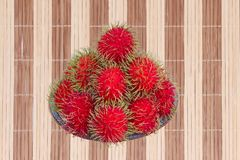 Red rambutan are edible in the serving dish. Thai popular fruit ,Red rambutan are edible in the serving dish Royalty Free Stock Image