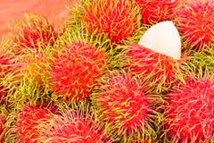 Red rambutan sweet delicious on  background healthy rambutan tropical fruit food  Stock Photo