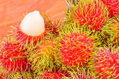 Red rambutan sweet delicious on  background healthy rambutan tropical fruit food isolated Royalty Free Stock Photography