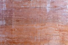Red Rammed Earth wall texture. With stained and cracked stock photography