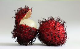 Red rampton fruit with one open fruit royalty free stock images
