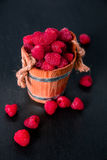 Red raspberries in a basket on black wooden background. Close up. Red raspberries in a basket on black wooden background Royalty Free Stock Photos