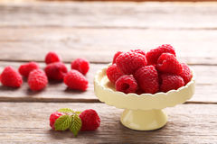 Red raspberries. On cake stand on grey wooden background Stock Photos