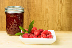 Red raspberries mint and jam or jelly. Red raspberries and mint with jelly or jam royalty free stock photo