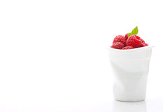 Red raspberries in a rumpled white cup Royalty Free Stock Images