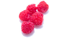 Red raspberries on white background. Selective focus. Images of red raspberries on white background. Selective focus Stock Photo