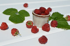Red raspberries on white table. Red raspberries in the summer on a white table Stock Photo