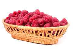 Red raspberries in a wicker basket isolated Stock Image
