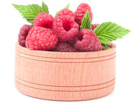 Red raspberries in a wooden bowl isolated on white background.  Stock Photography