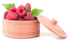 Red raspberries in a wooden bowl isolated on white background.  Royalty Free Stock Photography