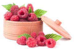 Red raspberries in a wooden bowl isolated on white background.  Stock Image