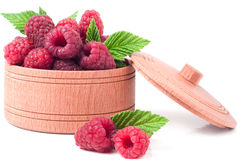 Red raspberries in a wooden bowl isolated on white background.  Stock Photo