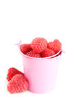 Red raspberry. In bucket isolated on a white Stock Image