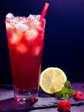 Red  raspberry cocktail with lime  on dark Royalty Free Stock Image
