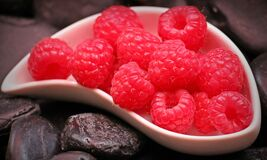 Red Raspberry Fruit on White Ceramic Tray Stock Photos