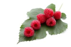 Red raspberry with green leaf. Berries ripe, red raspberry with green leaf isolated on white, fresh food concept Stock Photos