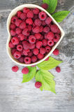 Red raspberry in heart Stock Image