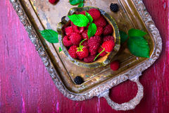 Red raspberry with leaf in a basket on vintage metal tray. Top view. Red raspberry with leaf in a basket on vintage metal tray. Top view Royalty Free Stock Photos