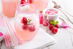 Red raspberry lemonade. Or cocktail in glasses with sugared rim royalty free stock photography