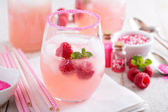 Red raspberry lemonade. Or cocktail in glasses with sugared rim stock image