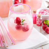 Red raspberry lemonade. Or cocktail in glasses with sugared rim royalty free stock images