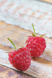 Red raspberry on old vintage wooden table. Stock Photo