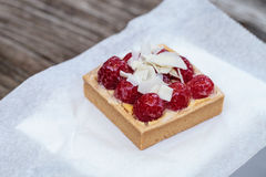 Red raspberry tart pastry with a cookie crust and white chocolat Royalty Free Stock Image