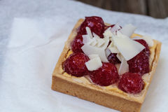 Red raspberry tart pastry with a cookie crust and white chocolat Royalty Free Stock Images