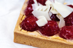 Red raspberry tart pastry with a cookie crust and white chocolat Stock Photo