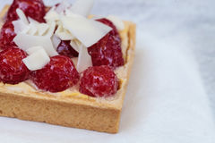 Red raspberry tart pastry with a cookie crust and white chocolat Stock Image