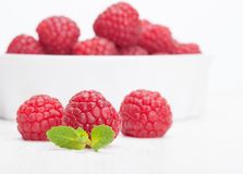 Red raspberry in a white bowl. Raspberry in a white bowl Royalty Free Stock Images