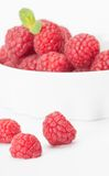 Red raspberry in a white bowl. Raspberry in a white bowl Stock Photography