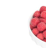 Red raspberry in a white bowl isolation. Raspberry in a white bowl isolation Royalty Free Stock Photo