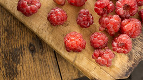 Red Raspberry. On wooden chopping board and table Royalty Free Stock Images