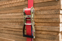 Red ratchet strap fixing wood boards / wooden planks Stock Images