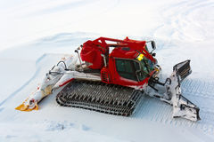 Red ratrak snowmobile. On snow Royalty Free Stock Photography