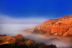 Red Ravine shrouded in fog Stock Photo