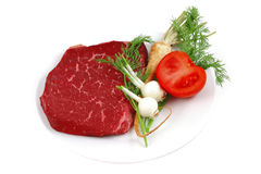 Red raw beef on white dish Royalty Free Stock Image