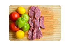 Red raw meat. Fresh vegetables and red raw meat on the cutting board stock images