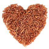 Red raw rice in heart shape, isolated Royalty Free Stock Image