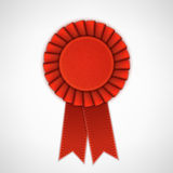 Red Realistic Textile Rosette with Ribbons. Royalty Free Stock Image